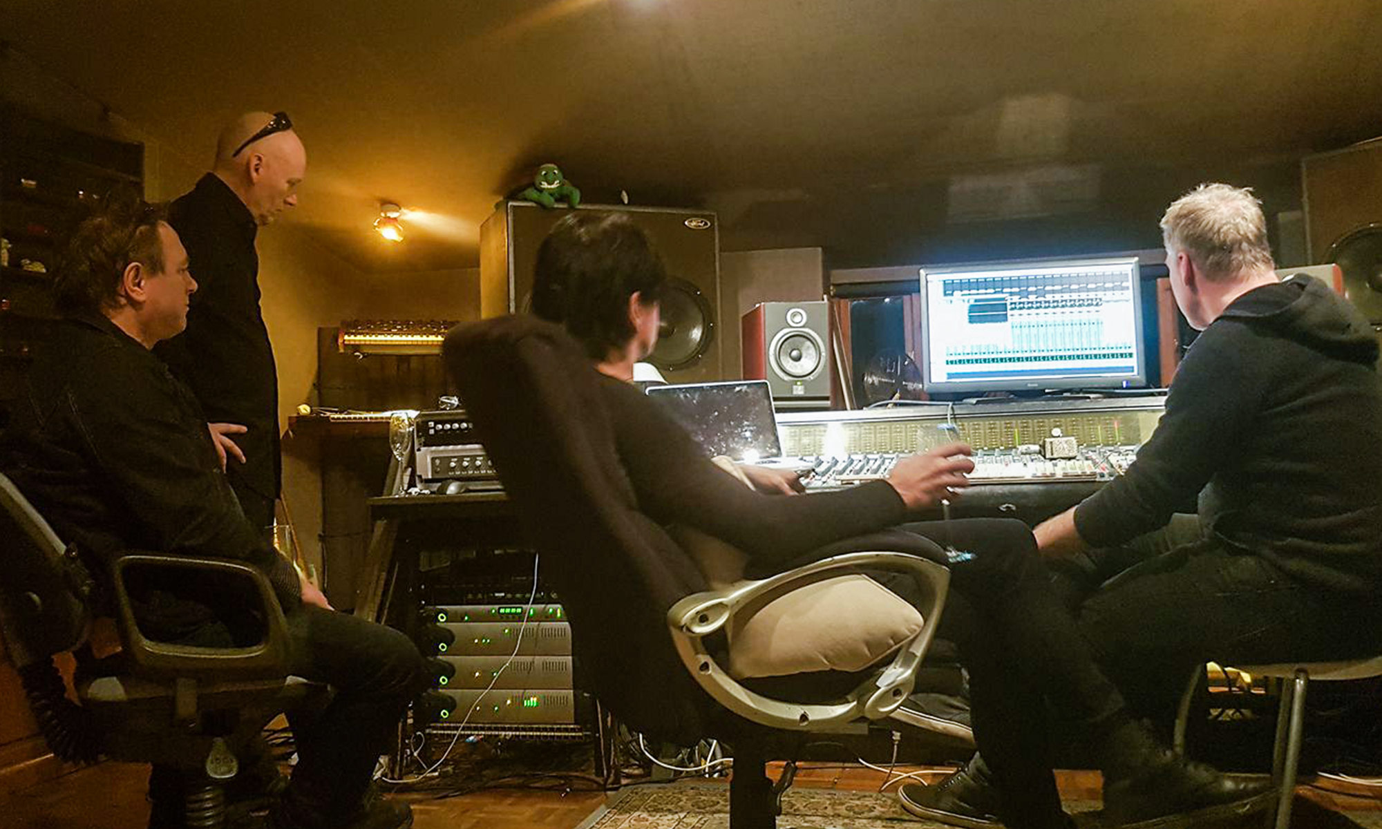 James, Pete, Jay and Peter Walsh listen to playback of the new songs.
